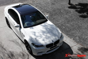 BMW M5 gloss black roof vinyl wrap
