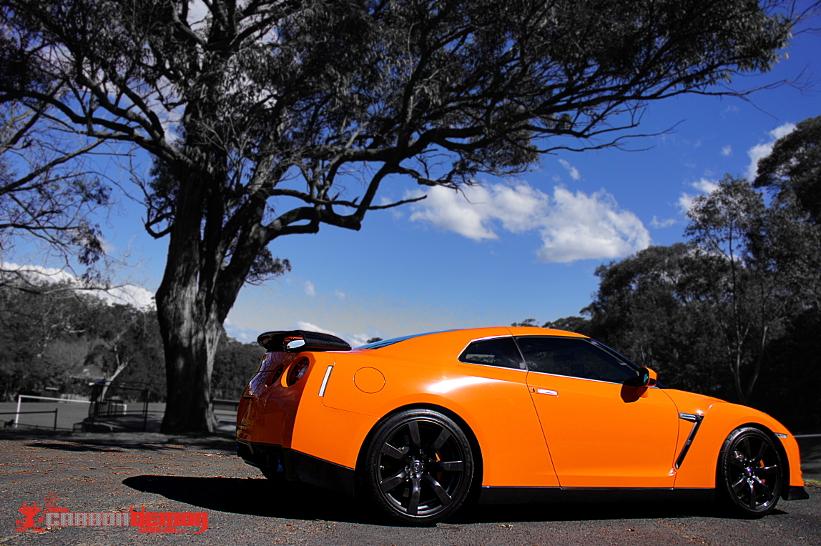 gloss orange vinyl wrap gtr r35 by carbon demon sydney
