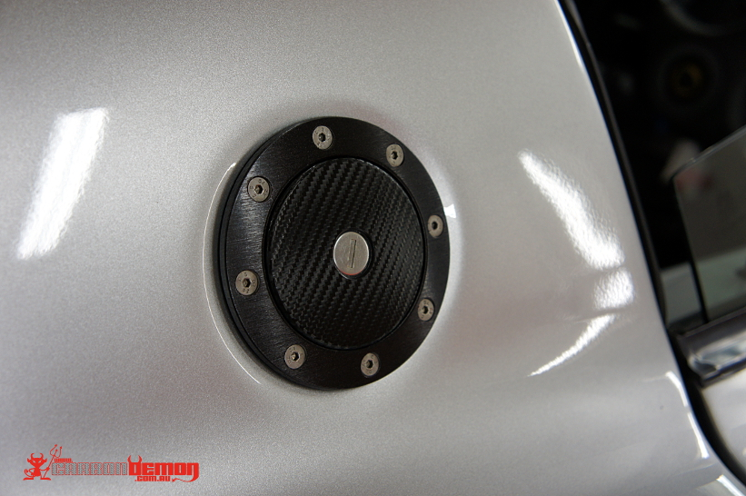 Lotus Exige (fuel lid wrapped in CF wrap & bezel wrapped in brushed black metal)