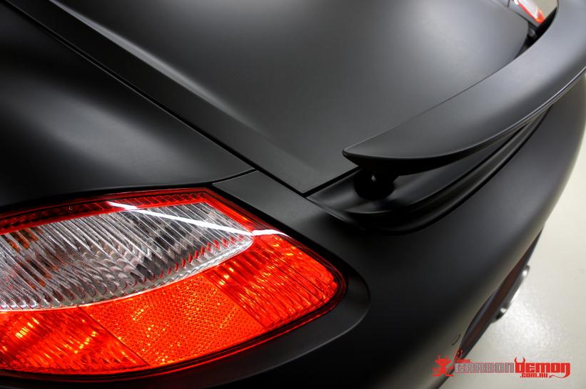 Matte black Porsche Cayman Vinyl Wrap Carbon Demon Sydney