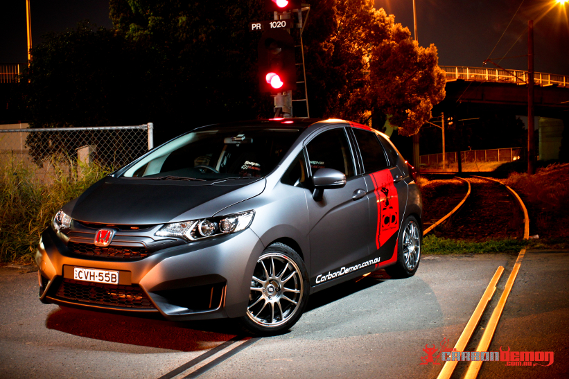 Honda Jazz modified with matte vinyl wrap - Carbon Demon (1)